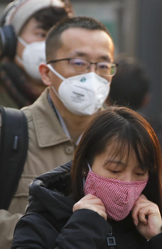 The air pollution in China causes much of the population to wear masks to filter the air. Picture: Andy Wong)