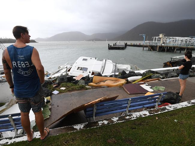 Locals inspect damage at Shute Harbour, Airlie Beach. Picture: Dan Peled/AAP