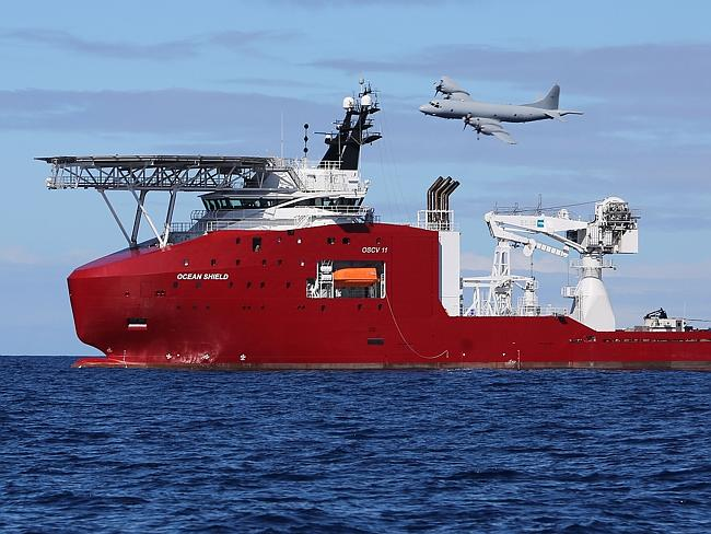 A Royal Australian Air Force AP-3C Orion flying past Australian Defence Vessel Ocean Shield on a mission to drop sonar buoys to assist in the acoustic search for missing Malaysia Airlines flight MH370.