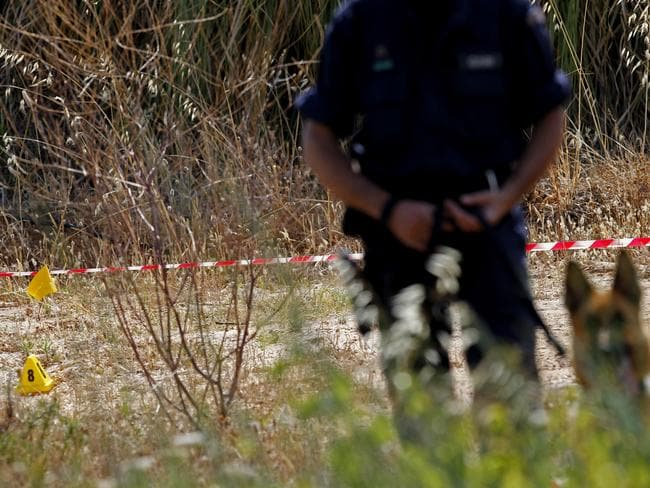 Police investigating the disappearance of Madeleine McCann cordoned off Monday an area of scrubland near where the British girl vanished seven years ago. Picture: AP