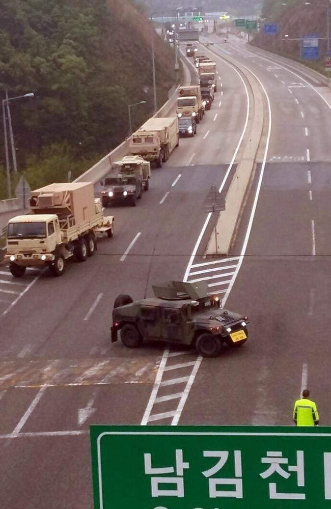 A convoy of US military vehicles carrying elements of the THAAD system drive to a golf course in Seongju. Picture: AAP Image/Yonhap News Agency
