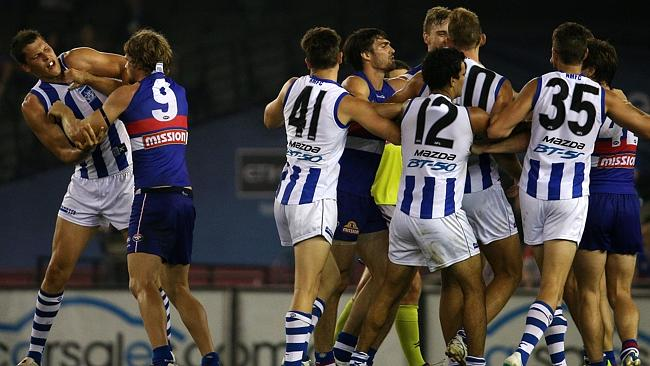 North Melbourne and Western Bulldogs lock horns at the main change. Picture: George Salpi