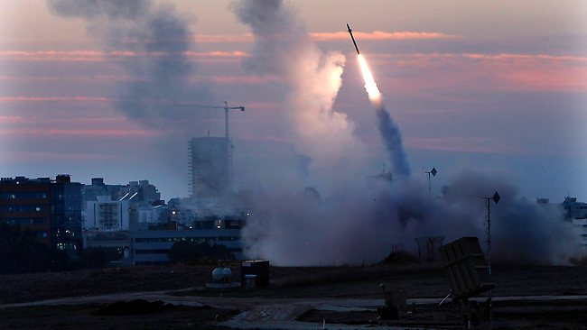The Iron Dome defense system fires to interecpt incoming missiles from Gaza in the port town of Ashdod on Thursday. (AP Photo /Tsafrir Abayov)