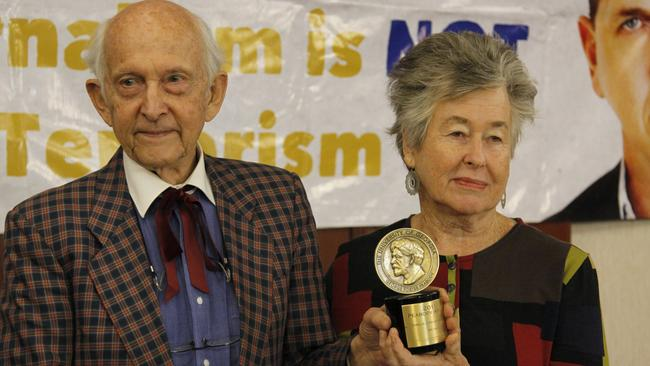 The parents of jailed Australian journalist Peter Greste, Juris Greste, left, and Lois Greste hold the Peabody journalism award given to their son in Nairobi, Kenya. Picture: AP