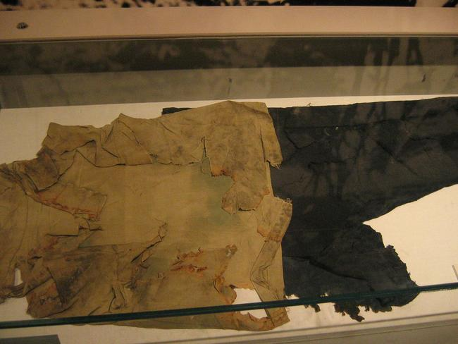 Burnt clothing is displayed as a tragic reminder. Picture: Rinze Wind.