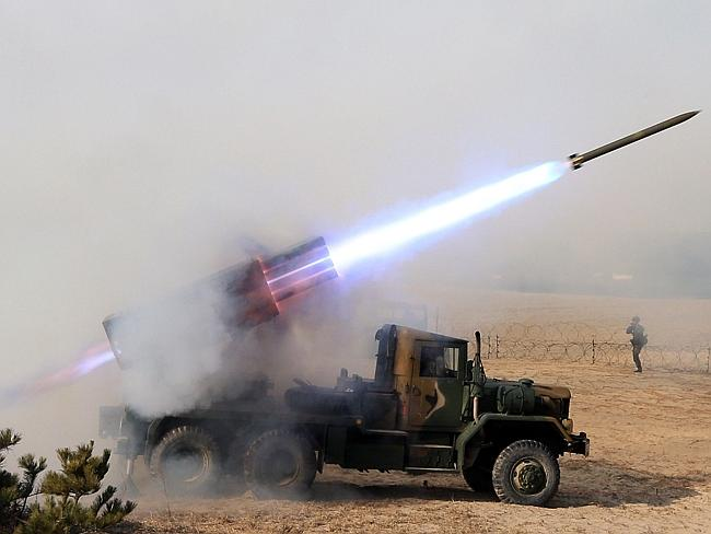 Military exercise...South Korean Army's 130mm multiple rocket launchers fire live rounds during a military exercise in the eastern border city of Goseong. Picture: AP