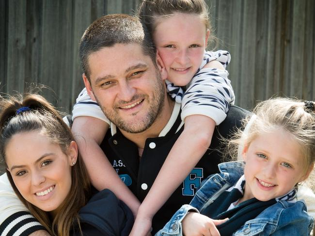 Brendan Fevola with his girls, Mia (17), Lulu (7) and Leni (10). Picture: Jay Town