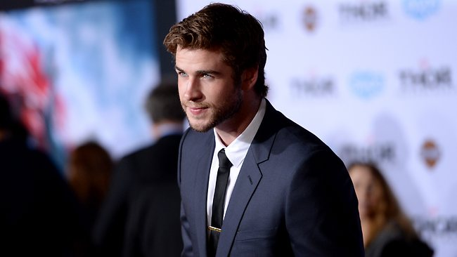 "HOLLYWOOD, CA - NOVEMBER 04: Actor Liam Hemsworth arrives at the premiere of Marvel's ""Thor: The Dark World"" at the El Capitan Theatre on November 4, 2013 in Hollywood, California. (Photo by Jason Merritt/Getty Images)"