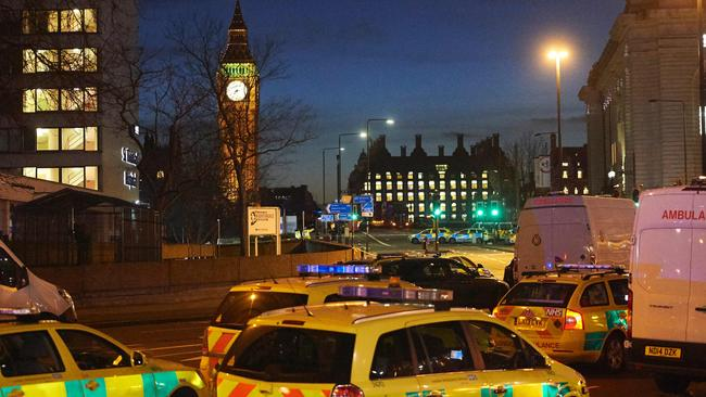 British police officers and emergency services work on Westminster Bridge in the aftermath of a terror incident. Picture: AFP