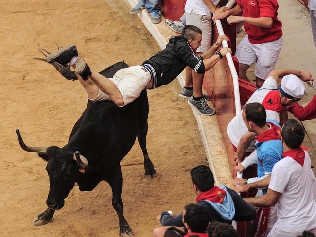 The 'action' continues inside the bull ring at the San Fermin festival.