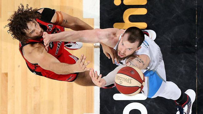 Will Hudson of the Breakers attempts to block a shot by Matthew Knight of the Wildcats during the 2013 NBL gand final series. The NBL is breaking away from Basketball Australia. Picture: Paul Kane