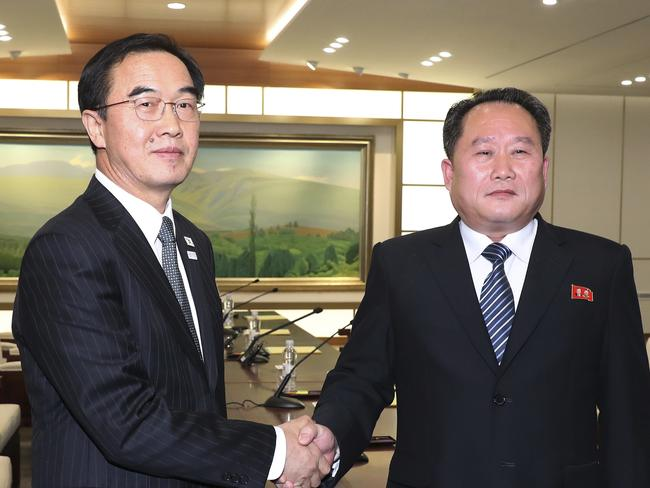 South Korean Unification Minister Cho Myoung-gyon (l) shakes hands with the head of the North Korean delegation Ri Son Gwon after their meeting at Panmunjom in the Demilitarized Zone. Picture: AP