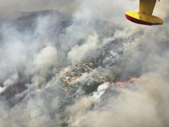 A Spanish firefighting plane flies over the fires in Pedrogao Grande, Portugal. Picture: AP