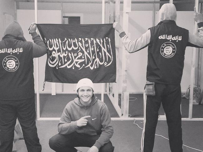 Examples of members standing in front of the Shahada flag. Radical Muslim leaders are rebooting social media accounts under false names with different profile photos in a bid to dodge a Facebook and Twitter crackdown and keep feeding ISIS propaganda to followers. The leaders of Sydney's hardline Muslim groups continue to maintain close links on social media, issuing pro-ISIS and jihadi paraphernalia online.