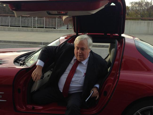 Standing firm ... Clive Palmer — who arrived at Parliament this morning in a Mercedes sports car — is not backing down from his comments about Peta Credlin.