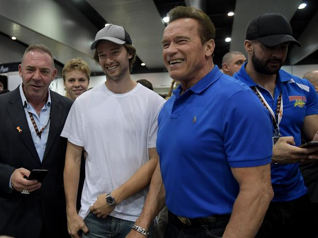 American actor Arnold Schwarzenegger (right) with his son Patrick Schwarzenegger pictured in Melbourne on Friday. Schwarzenegger popularised bodybuilding as a sport in the 1980s. Picture: Tracey Nearmy / AAP