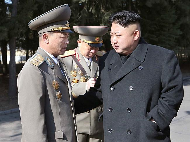 North Korean leader Kim Jong-Un talking with a candidate in the election of deputies to t