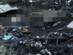 Bodies can be seen among the wreckage of the Malaysia Airlines flight travelling from Amsterdam to Kuala Lumpur after it crashed into a field. Picture: AFP