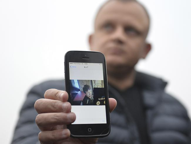 Ariel Zurawski, the owner of a Polish trucking company, shows the last photo taken of his cousin and driver, Lukasz Urban. Picture: AP Photo