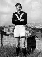 Essendon's Bill Hutchison poses in a Victorian jumper in the garden of his Aberfeldie home in 1950.