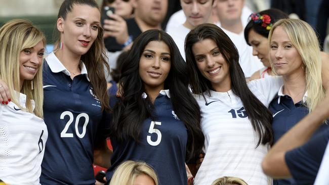 French Wags, from left Fiona Cabaye wife of France's midfielder Yohan Cabaye, the girlfriend of France's forward Loic Remy, Mazda Magui the wife of France's defender Mamadou Sakho, Ludivine Sagna the wife of France's defender Bacary Sagna and Sandra Evra the wife of France's defender Patrice Evra attend Thursday's match.