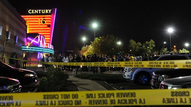 People gather outside the Century 16 movie theatre in Aurora, Colrado, at the scene of a mass shooting. Police Chief Dan Oates says 14 people are dead following the shooting at the suburban Denver movie theatre. AP