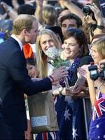 Prince William accepts a native flower from the crowd at South Bank. Pic: Darren England