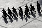 <p>Chinese paramilitary police march across a closed square following a riot in Urumqi. Picture: AP</p>
