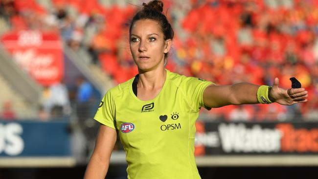 Could AFL umpires like Eleni Glouftsis be adjudicating the last-disposal out-of-bounds rule in the AFL one day? AFLW is set to introduce it for 2018. Picture: AAP