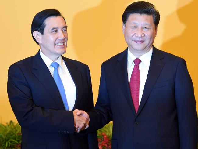 Will handshake change anything ... Chinese President Xi Jinping (R) shakes hands with Taiwan President Ma Ying-jeou. Picture: AFP