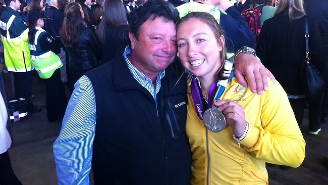 Silver medal winning diver Olivia Price welcomed by her dad David. Picture: Ross Schultz