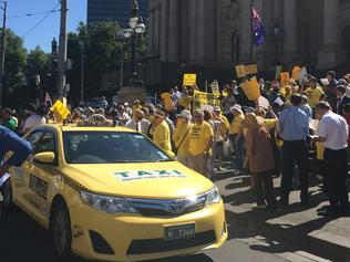 Cab drivers gather in Melbourne to protest the Victorian government's proposed changes to the taxi industry on Monday, Feb 27, 2017 (AAP Image/Rachel Gray) NO ARCHIVING