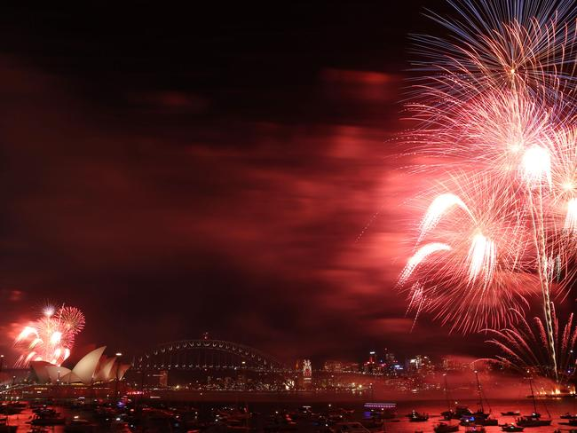 Stunning show ... thousands gathered at Mrs Macquarie's Chair in Sydney to watch the 9pm fireworks. Picture: Britta Campion/The Australian