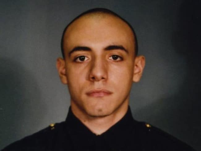 """Living his dream"" ... Police Officer Melvin Santiago. Santiago was shot in the head while still in his police vehicle."