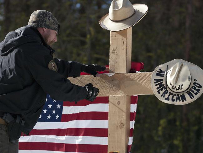 Memorial ... a self-proclaimed patriot places a note at the site where LaVoy Finicum was shot and killed by federal agents on January 26. Picture: Matt Mills McKnight/Getty Images/AFP