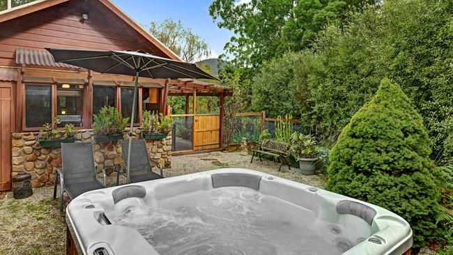 The three cottages open out to private spas nestled among the greenery.
