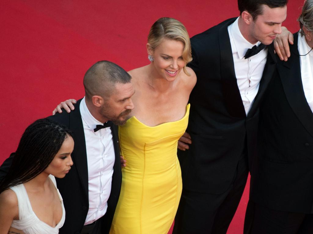"""Zoe Kravitz, Tom Hardy, Charlize Theron, Nicholas Hoult and Australian director George Miller pose as they arrive for the screening of the film """"Mad Max : Fury Road"""". Picture: AFP"""