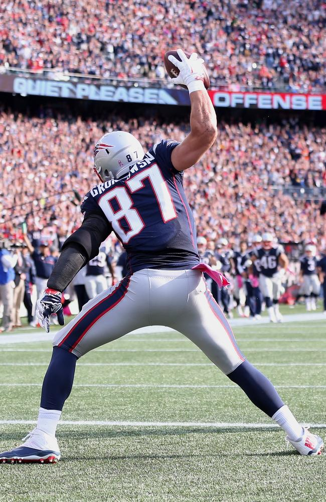 Rob Gronkowski #87 of the New England Patriots spikes the ball after scoring.