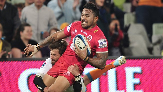 Digby Ioane of the Reds tackled by Willie le Roux of the Cheetahs in Bloemfontein. The Cheetahs upset the Reds in the Super Rugby clash. Picture: Loren Battersby