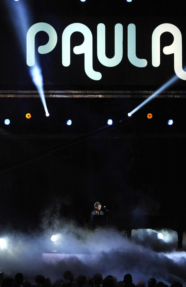 Robin Thicke performs on stage at the BET Awards, his estranged wife's name in lights. Not creepy at all, buddy. Picture: AP