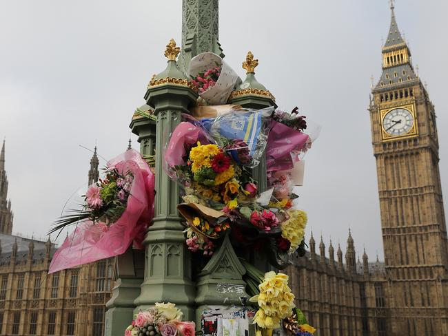 Flowers are left on Westminster Bridge by the Houses of Parliament in memory of those who died in the Westminster terror attack on March 27. Picture: Getty.