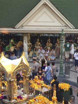 The Erawan Shrine, pictured earlier this year, is a popular shrine to the Hindu god Brahma and is visited by Buddhist devotees daily. (AP Photo/Charles Dharapak)