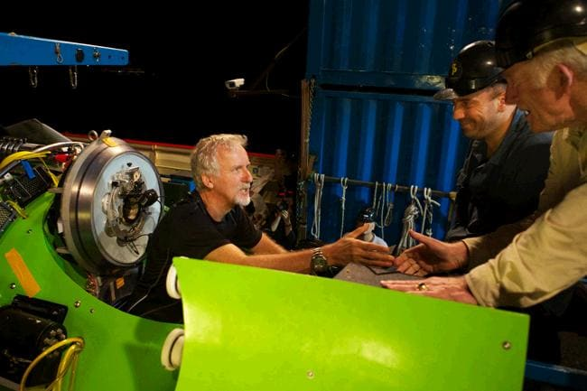 James Cameron gets a handshake from ocean explorer and U.S. Navy Capt. Don Walsh, right, just before the hatch on the Deepsea Challenger submersible is closed and the voyage to the deepest part of the ocean begins. Walsh took the same journey to the bottom of the Mariana Trench 52 years ago in the bathyscaphe Trieste with Swiss oceanographer Jacques Piccard. Cameron is the first person to complete the dive solo. Picture: Mark Thiessen / National Geographic