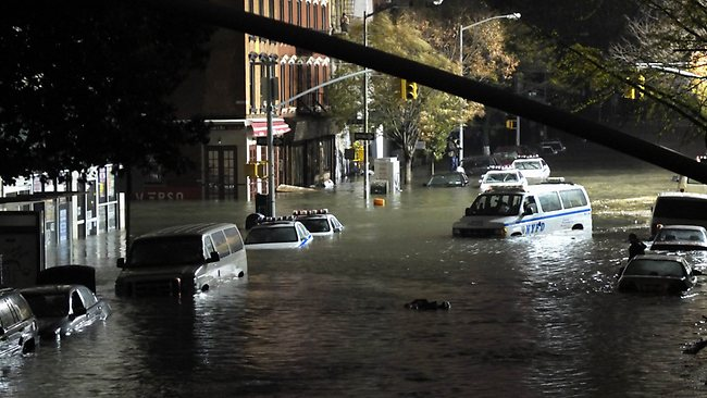 A general view of submerged cars on Ave. C and 7th st, after severe flooding caused by Hurricane Sandy. Picture: Christos Pathiakis