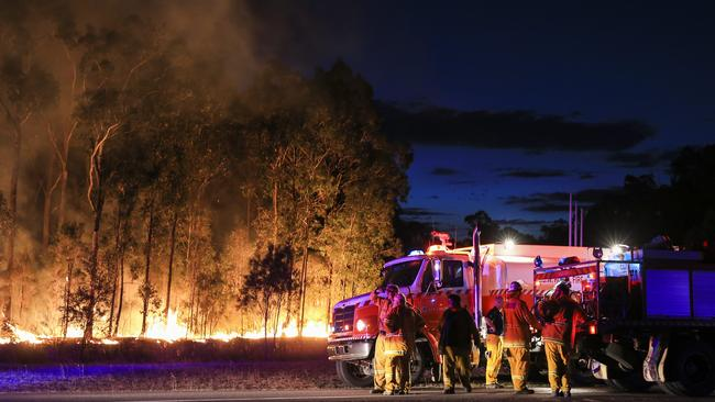 Rural Fire Service crews working into the night to beat back fires near Cessnock. Picture: Dylan Robinson
