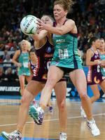 Tegan Caldwell contests the ball with Firebirds opponent Clare McMeniman. Picture: Norm Oorloff