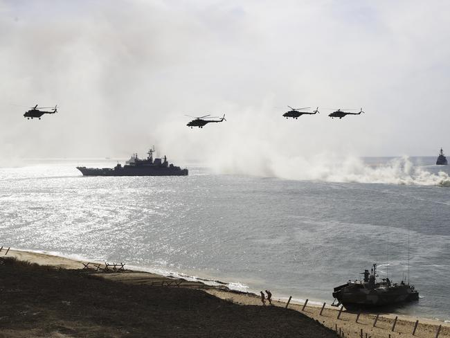 Russian navy ships and helicopters take a part in a landing operation during military drills at the Black Sea coast, Crimea, last year. Picture: AP