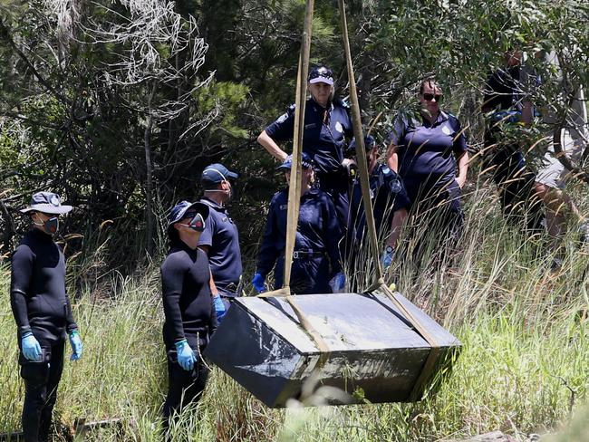 The makeshift coffin had holes drilled in the sides to help it sink. Picture: Jono Searle