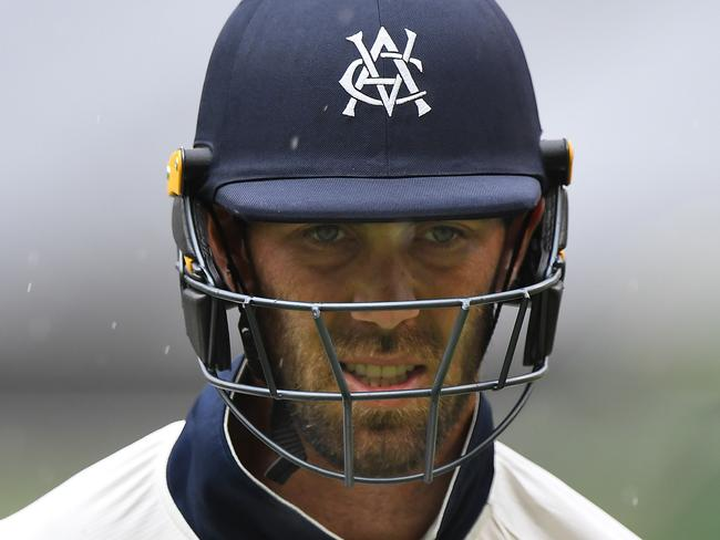 Glenn Maxwell of Victoria makes his way from the ground as rain interrupts plays during day three of the JLT Sheffield Shield cricket match between the Victorian Bushrangers and Tasmanian Tigers at the MCG in Melbourne, Wednesday, November 15, 2017. (AAP Image/ Julian Smith) NO ARCHIVING, EDITORIAL USE ONLY, IMAGES TO BE USED FOR NEWS REPORTING PURPOSES ONLY, NO COMMERCIAL USE WHATSOEVER, NO USE IN BOOKS WITHOUT PRIOR WRITTEN CONSENT FROM AAP