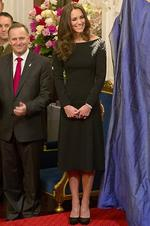 <p>Wearing a frock by British designer Jenny Packham Catherine, Duchess of Cambridge look on as they attend an art unveiling of a portrait of Queen Elizabeth II by New Zealand artist Nick Cuthell during Day 4 of a Royal Tour to New Zealand. Picture: Getty</p>